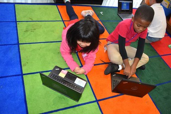 students using their SMART laptops