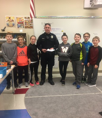 Officer Michnock from EV Police Department visits the EV News team for the weekly broadcast
