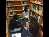 Alani, Trinity, and  Julia study hard
