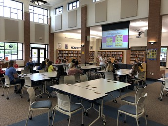 Ms. Watson working with English classes on UHS Library Media Center learning.
