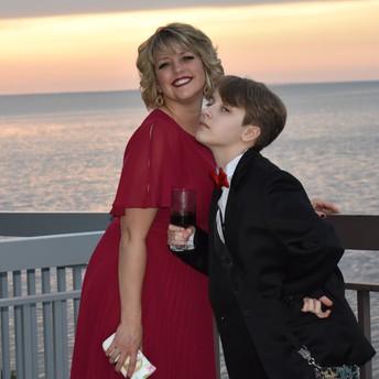 Lee Ann Ferguson with daughter, Audrey Ferguson, enjoying the sunset during the SGS Ruby Anniversary Gala.