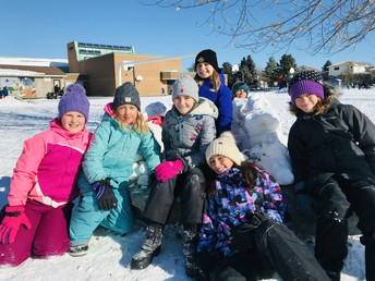 We use teamwork and have a lot of fun creating our snow structures!