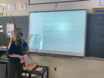 Mrs. Smith shares information regarding Google mail/classroom with students in Social Studies.