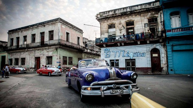 Take a neon tour of Havana in one of our convertibles!