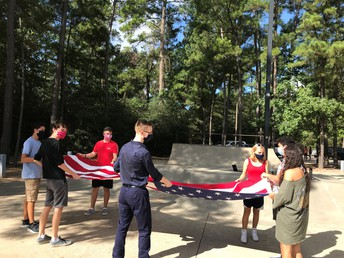Staff folding the giant flag