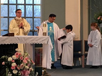 Celebrating School Mass with Fr. Edgar and Deacon Mike