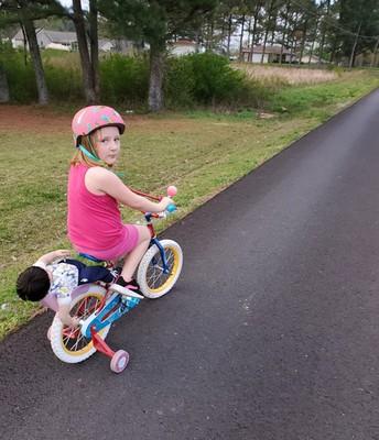 Roslyn is riding her bike.