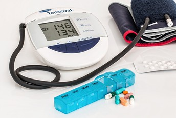 Blood pressure cup and pills