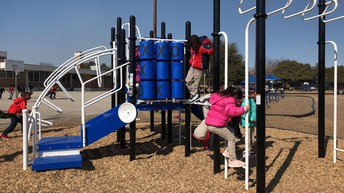 Students enjoying the new Pre-K playground that came with the new Annex Building.