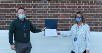 Teacher receiving award