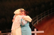 Aunt Eller and Laurey sharing a hug on stage!
