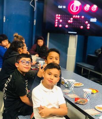 2nd Graders Taking a Break (notice the  Bingo #s on TV screen)