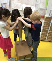 Kindergarten students problem solve to connect the arms.