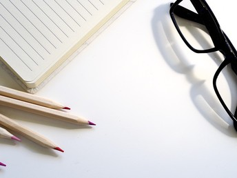 pencils, reading glasses, notebook