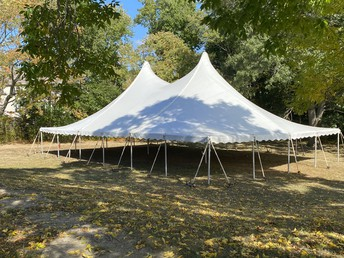 A tent has been set up for an additional outdoor space for music, physical education, and academic classes