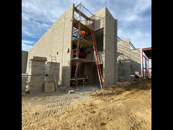 Entry to instructional wings being installed near the elevator shaft.