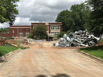 transformation from cafeteria building to a pile of recyclable materials