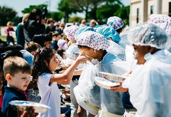 """Elementary students """"pie"""" fourth graders after exceeding the fundraising goal for World Vision."""