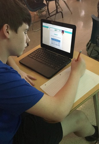 Middle School Students Use Technology to Help Learn Finance