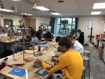 Students in art class working on their designs