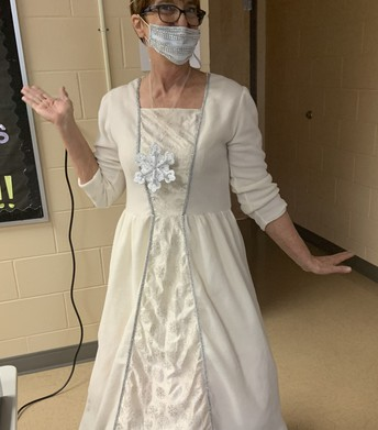 Teacher dressed in a white ball gown with snowflakes as the Snow Queen