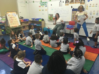 A kindergarten class excited about reading!