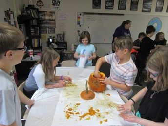 Fourth grade students used pumpkins to learn about measurements and capacity.