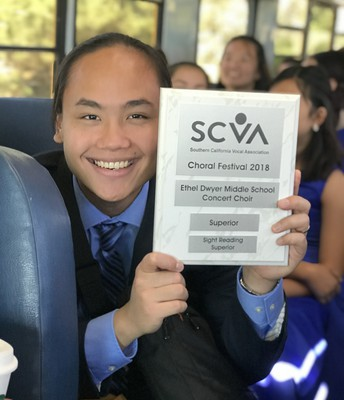 A proud Mr. Reyes showing off the Superior plaque