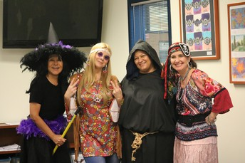 Front office ladies enjoy cutting up for the day.