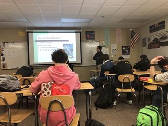 Guest speaker in Mr. Davis' Consumer Math class