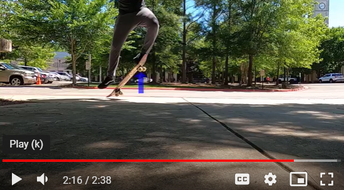 STUDENT GOING OFF CONCRETE SURFACE ON SKATEBOARD