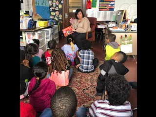 Mrs. Ramzi reads to Mrs. McGonnigle's class