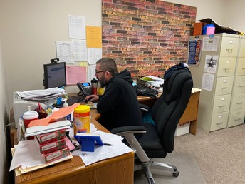 Mr. Alexander getting prepared to work with students
