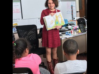 Barbara Morse reads to Mrs. Stover's class