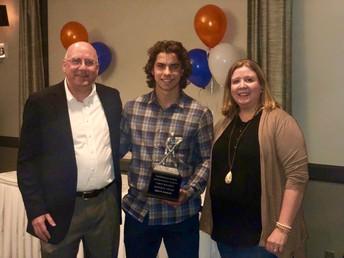 Brett Martin is awarded the trophy & scholarship