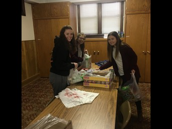 Spanish Club Offers Help With Backpack Program