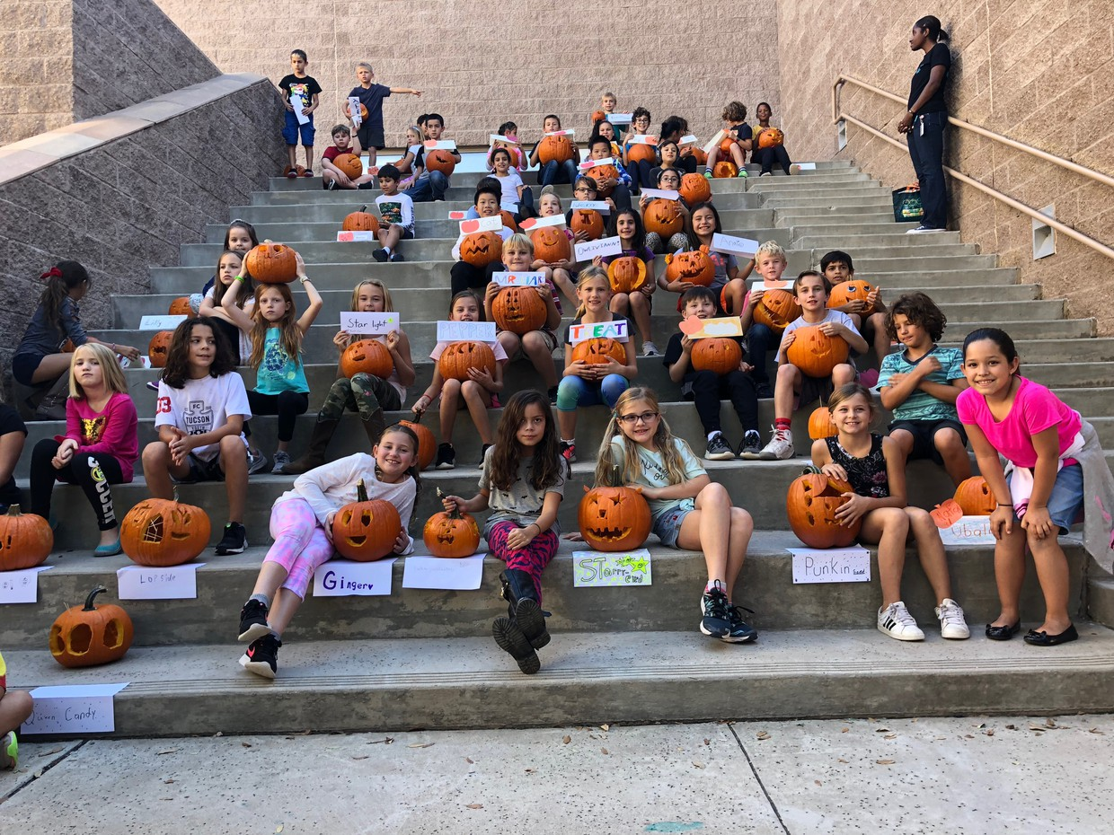 Students on stairs with jack-o-lanterns