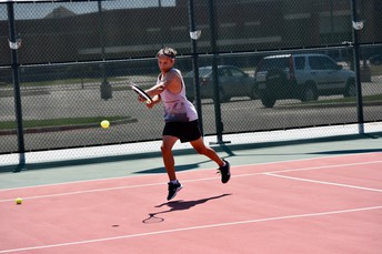 Micah Sharpe with the backhand