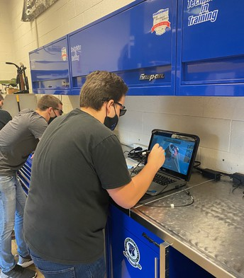 Automotive Technology student working with the  12 zSpace 3D VR laptop.