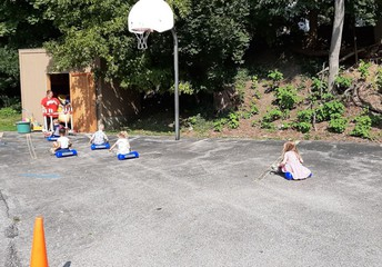 PreK gets some driving time on the blacktop