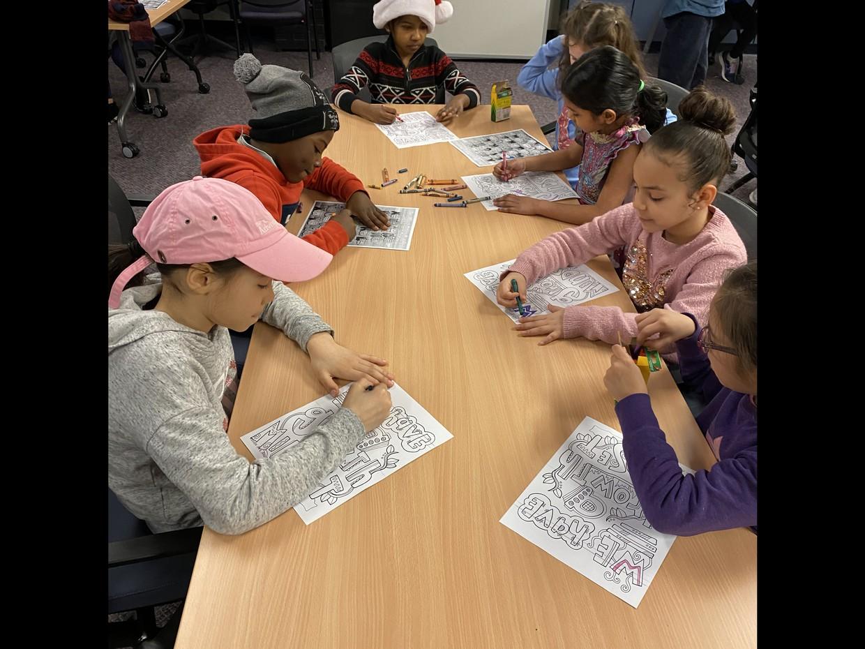 Students completing a Villa activity