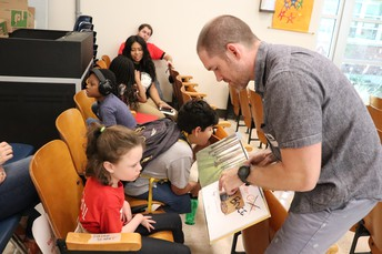 Author Ryan Higgins reading one of his books, Mother Bruce, to a very special Clairemont student.