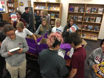 Students checking out the new books