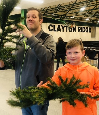 Lane Helps Mr. Radcliffe Trim the Tree for Winterfest