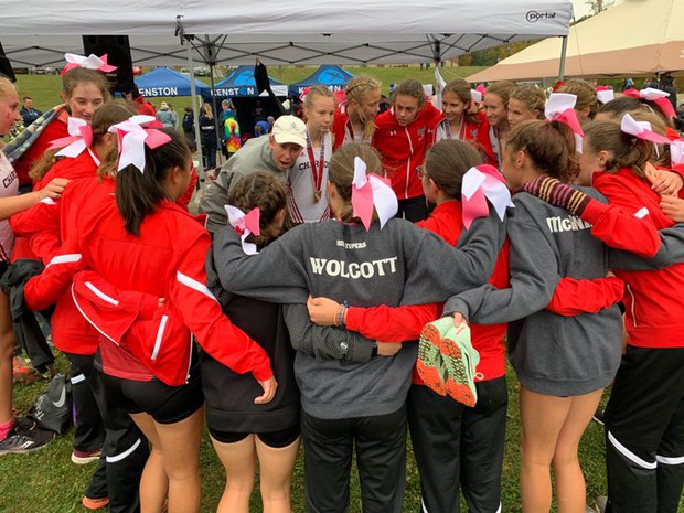 """Today (October 12), the Topper ladies all showed up wearing pink socks and sported pink ribbons in their hair at today's WRC meet. As a stage III survivor, Pinktober always bring mixed emotions."" ~Coach Julie Cole"