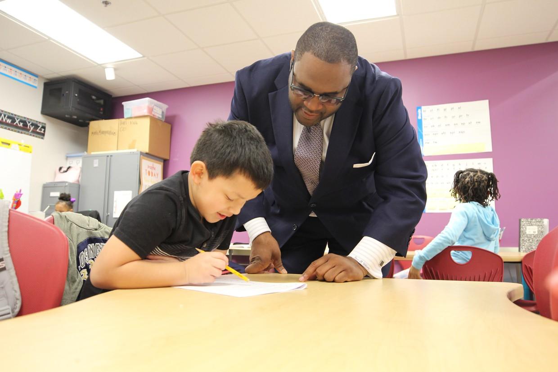 District 1 school board member Matthew Wilson with TCS student