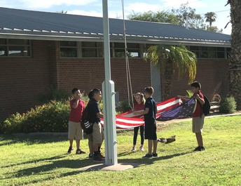 Hartford fifth graders care for United States flag daily