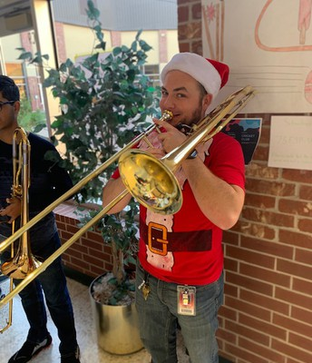 Slusser performs with holiday band