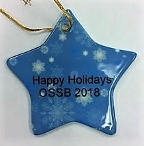 Shown in photo is a light blue ceramic star with white snowflake design and words in black that say Happy Holidays OSSB 2018.