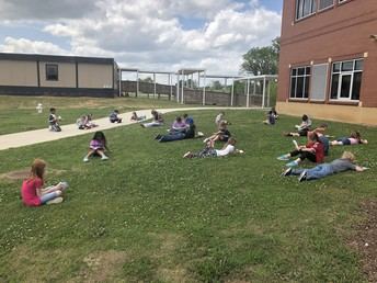 Enjoying the Spring Weather by reading outside!